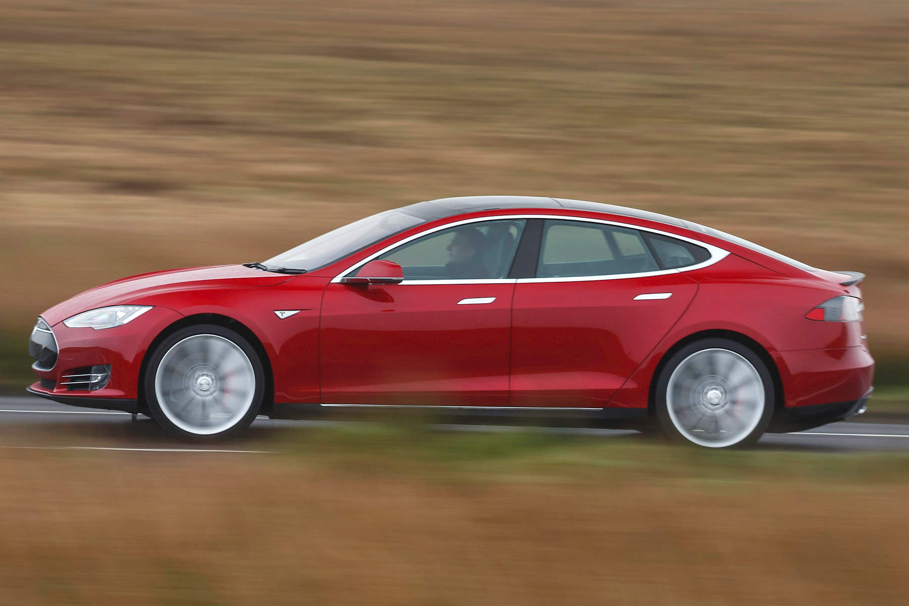 We 'drive' Tesla's driverless car on UK roads