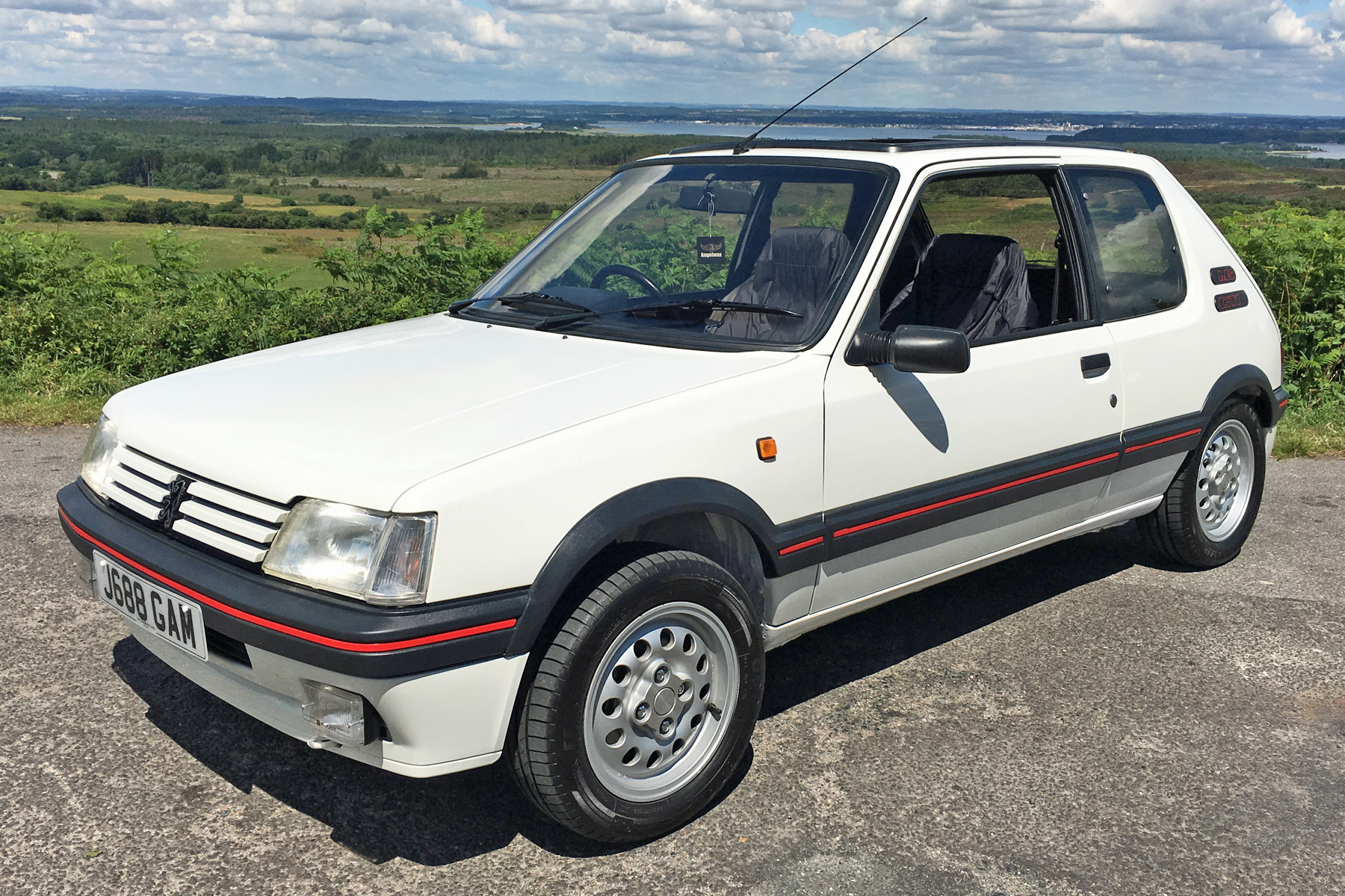 peugeot 205 gti 1 6 vs peugeot 205 gti mi16 retro road test motoring research. Black Bedroom Furniture Sets. Home Design Ideas