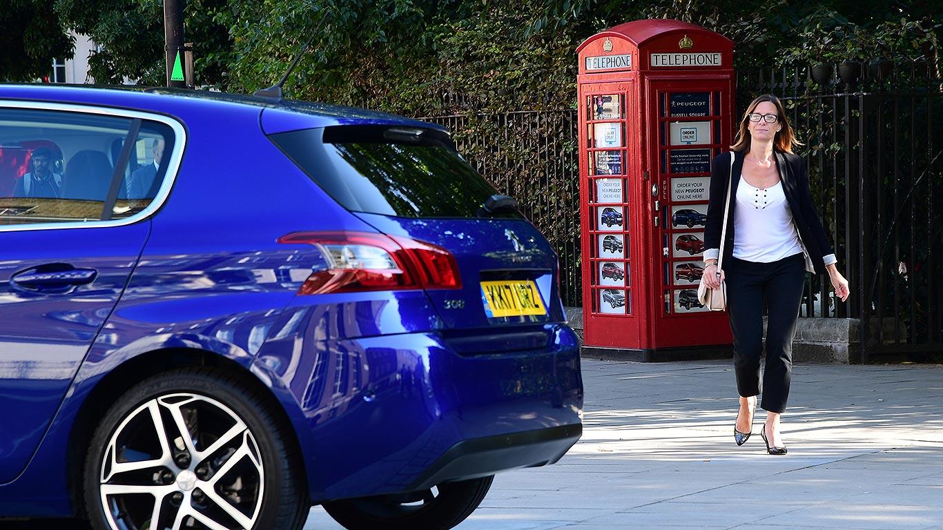 Peugeot telephone box car dealer