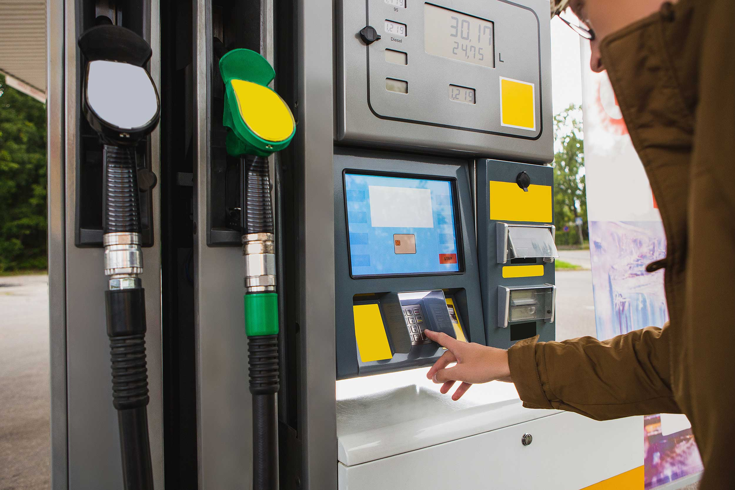 Motorist using a pay-at-pump filling station