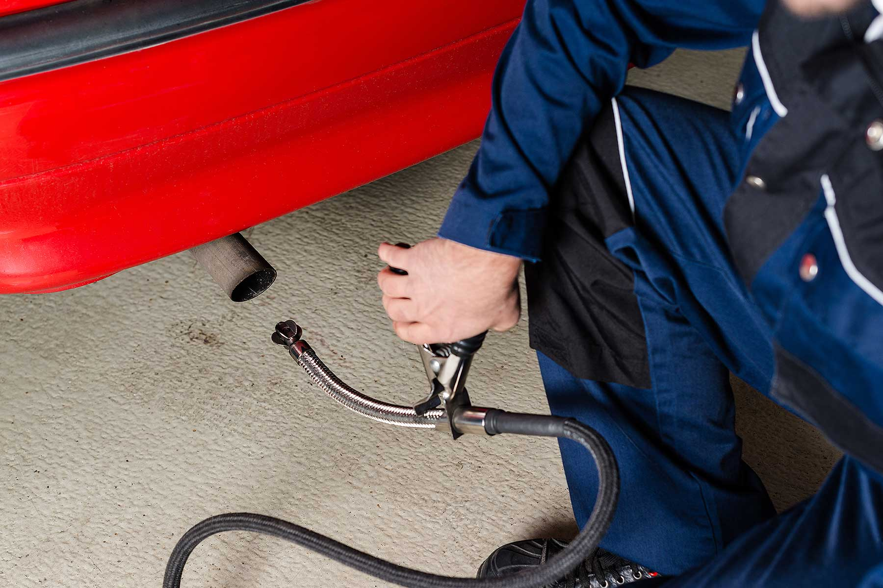 Technician conducting an MOT emissions test