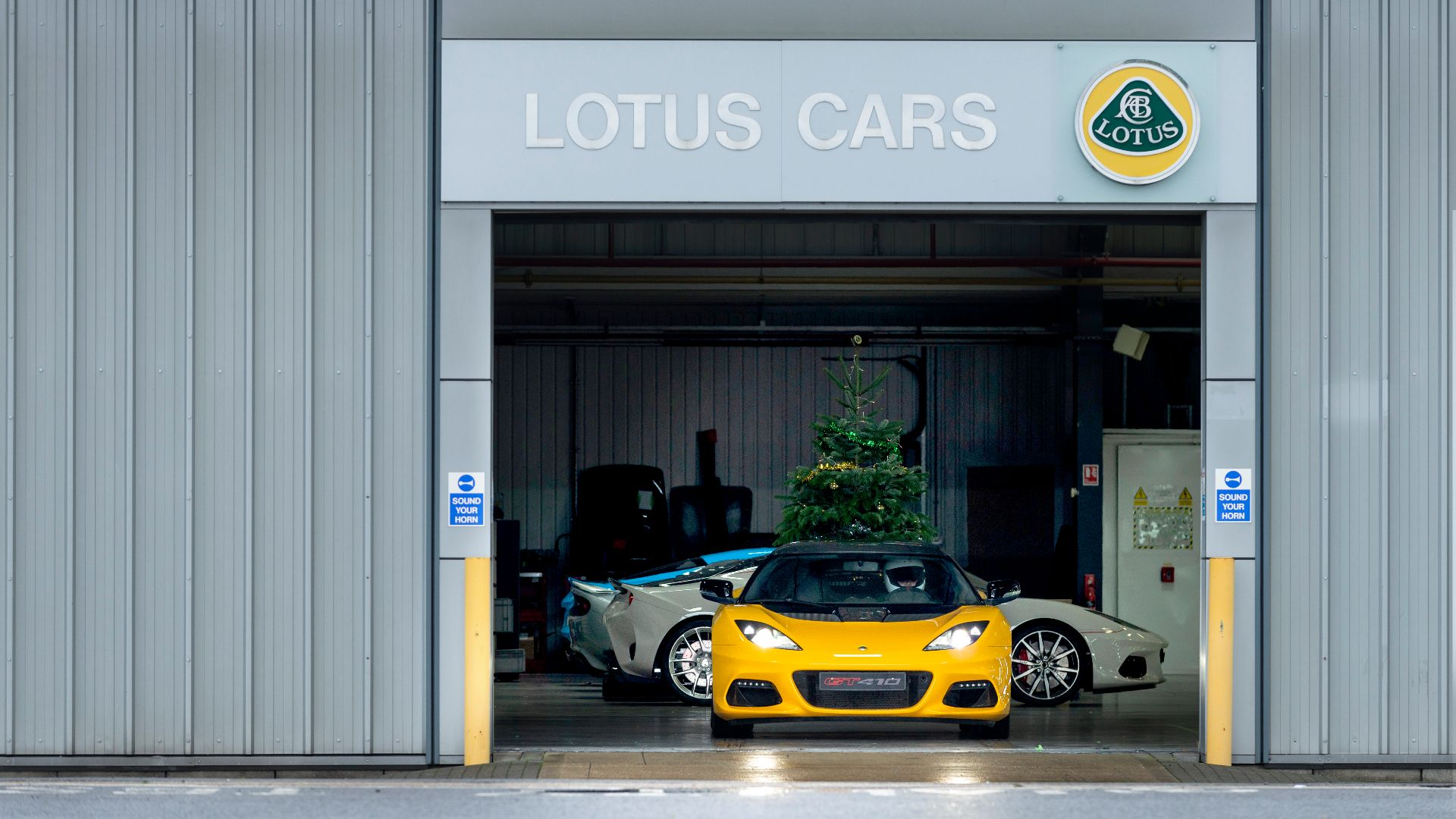 #DriftmasEvora Lotus GT410 Sport lines up outside #HandmadeinHethel factory before burning off sideways for #MerryDriftmas video