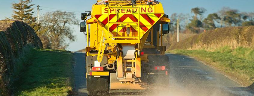 Road gritter spreading salt in winter
