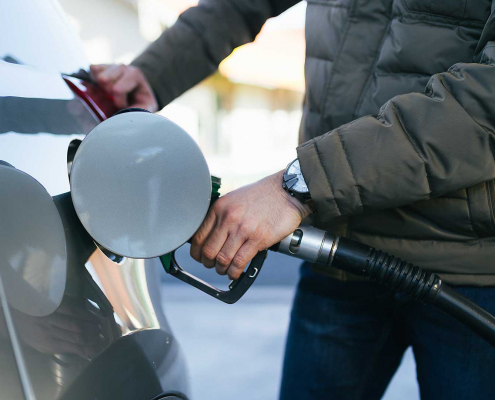 Driver filling a car with diesel fuel