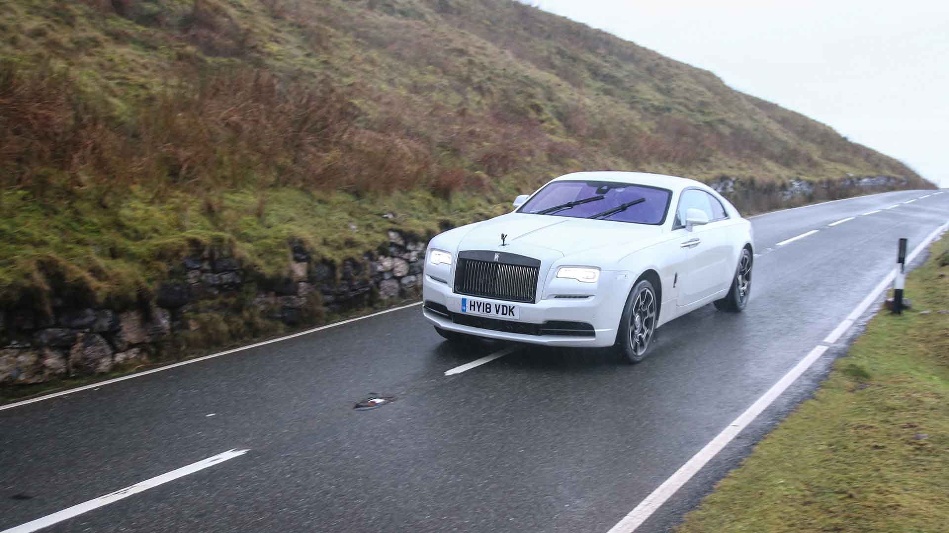 Rolls-Royce Wraith Black Badge in the rain