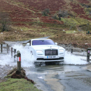 Rolls-Royce Wraith Black Badge driving through ford