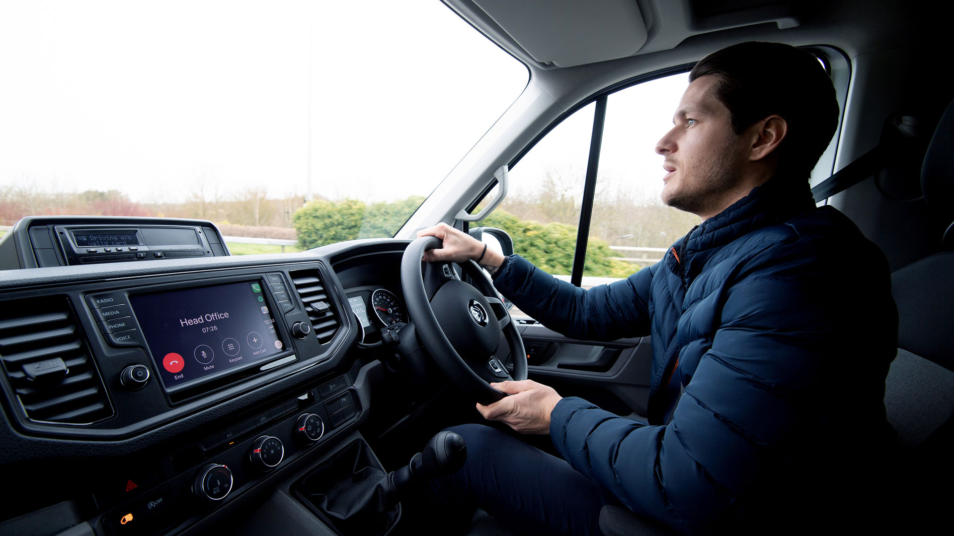Van driver on the phone to head office