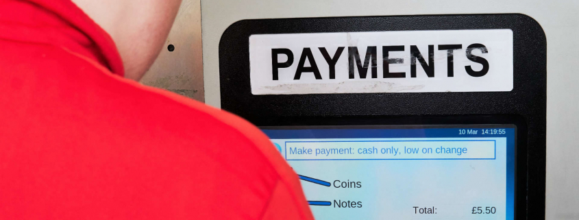 Driver paying for parking at NCP car park