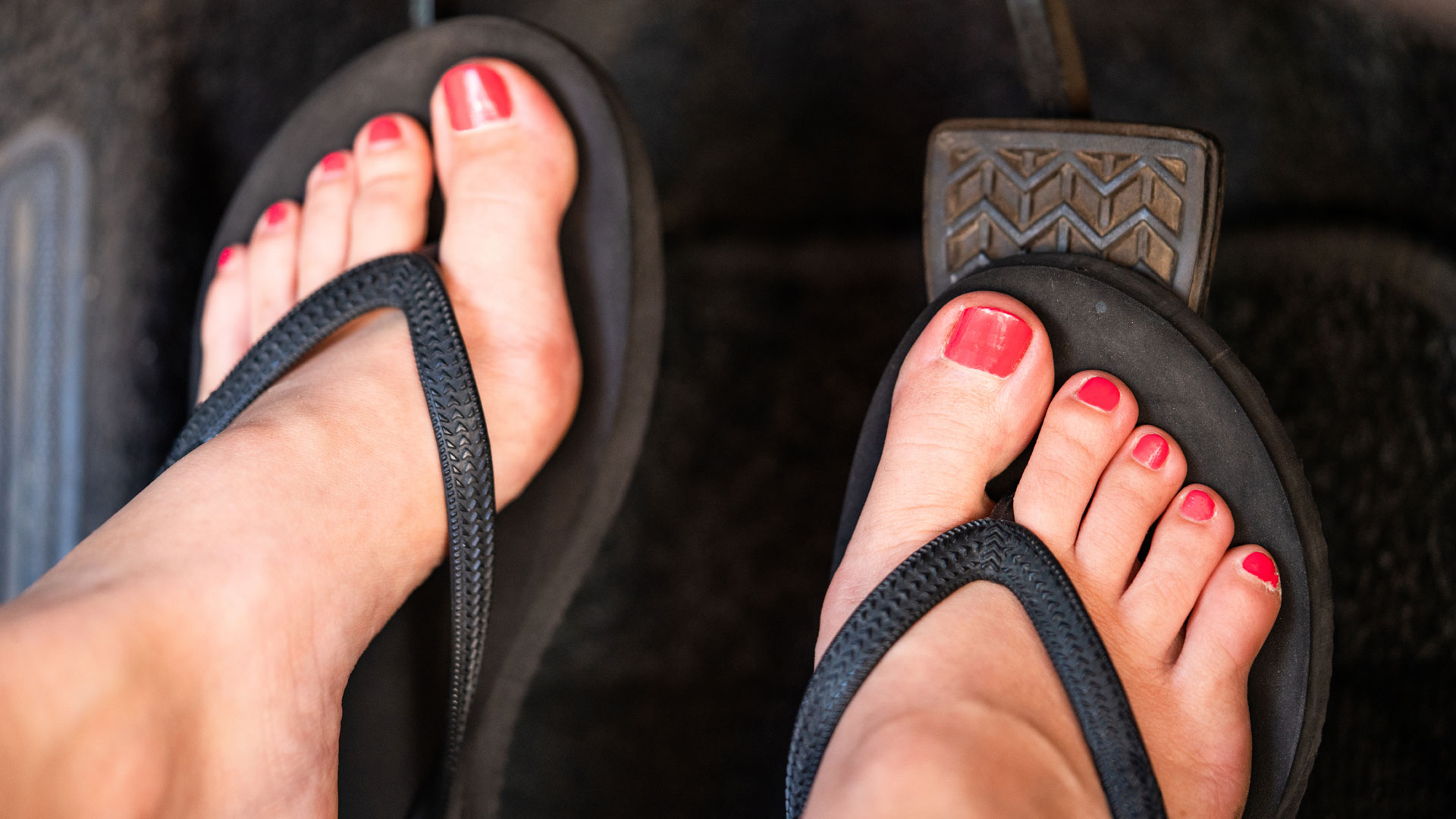 Woman driving in flip flops