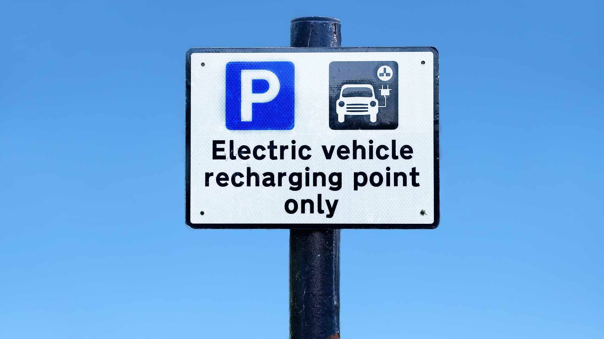 Electric vehicle recharging point warning sign