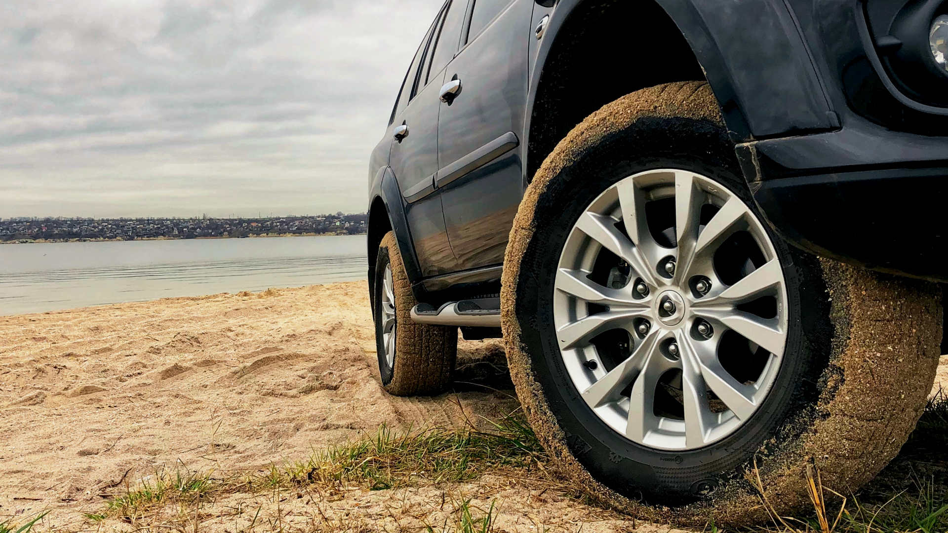 SUV tyre next to the water