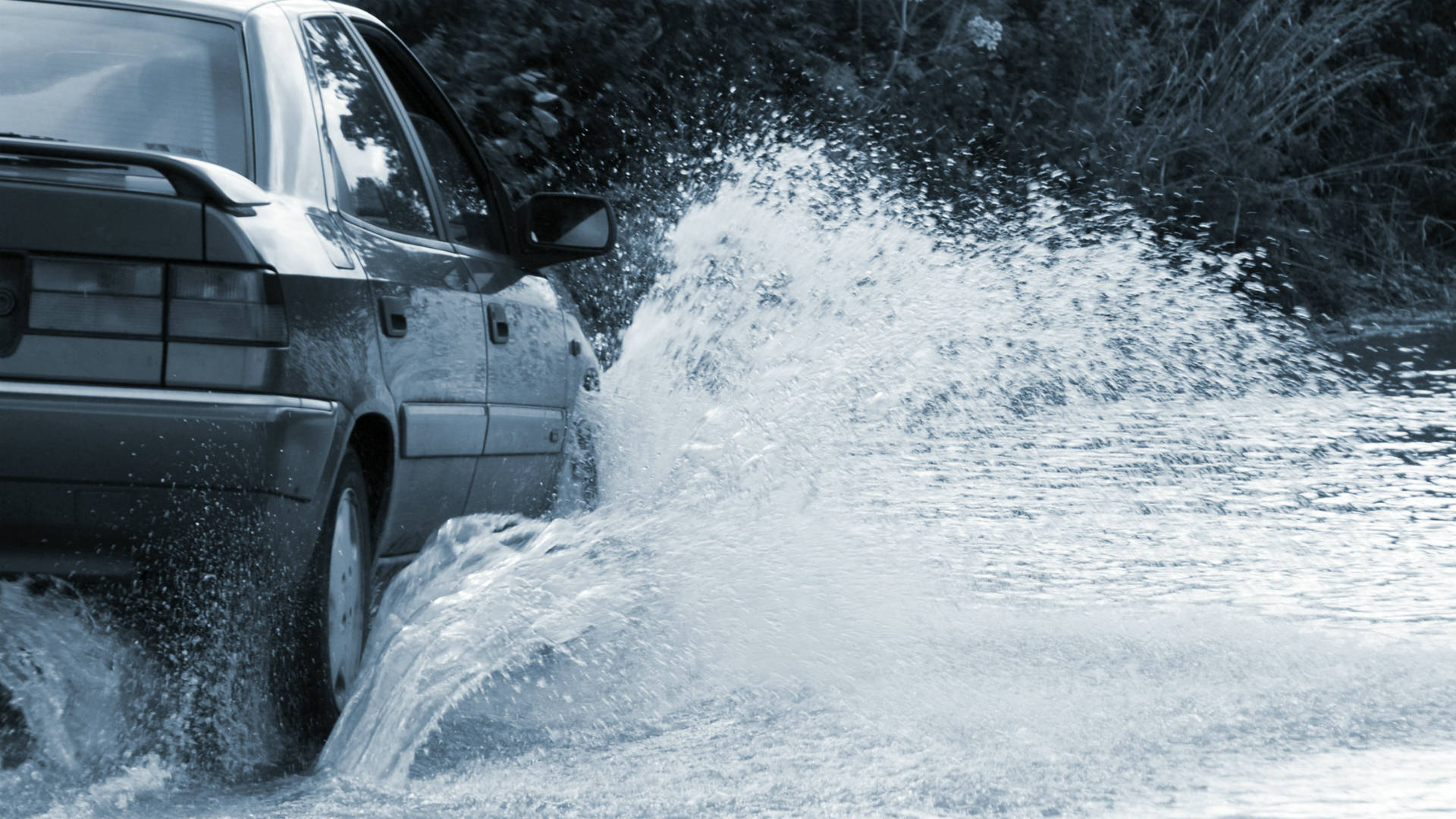 How to drive safely through flood water
