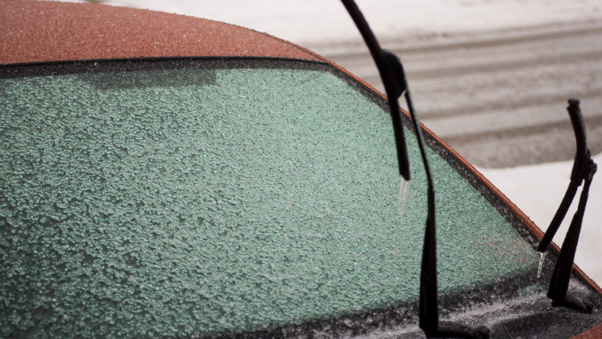 Frozen windscreen with wipers upright
