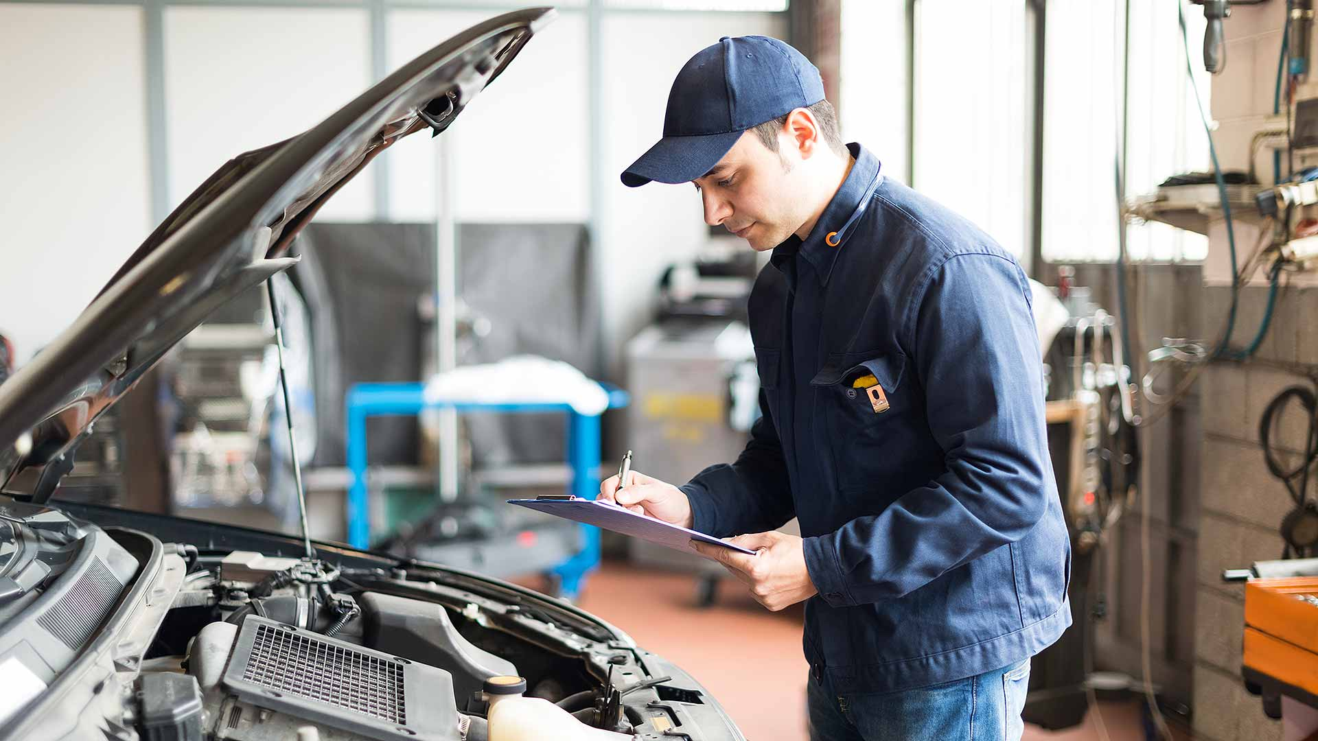 Technician carrying out a car MOT