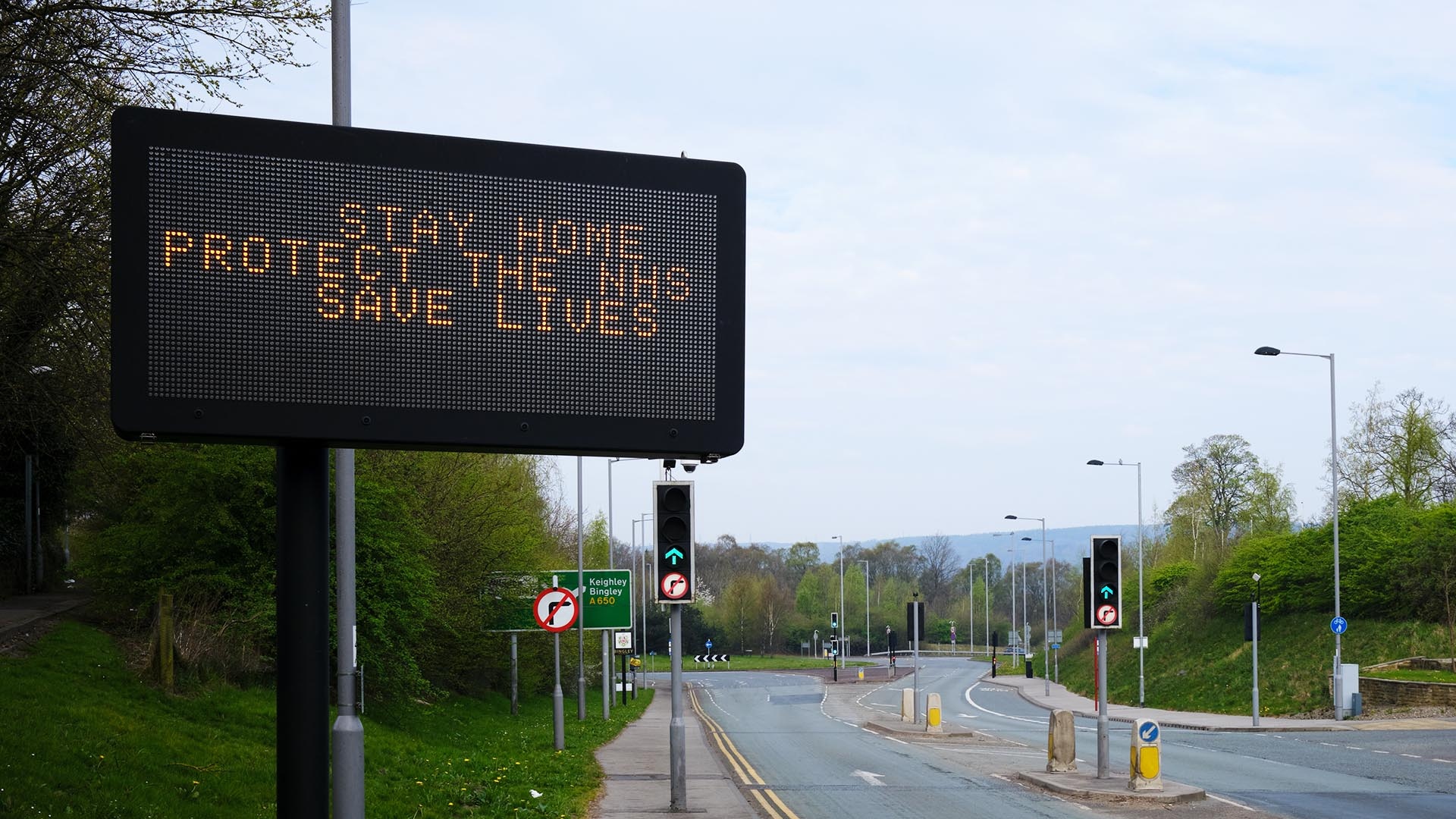 Stay home road sign UK