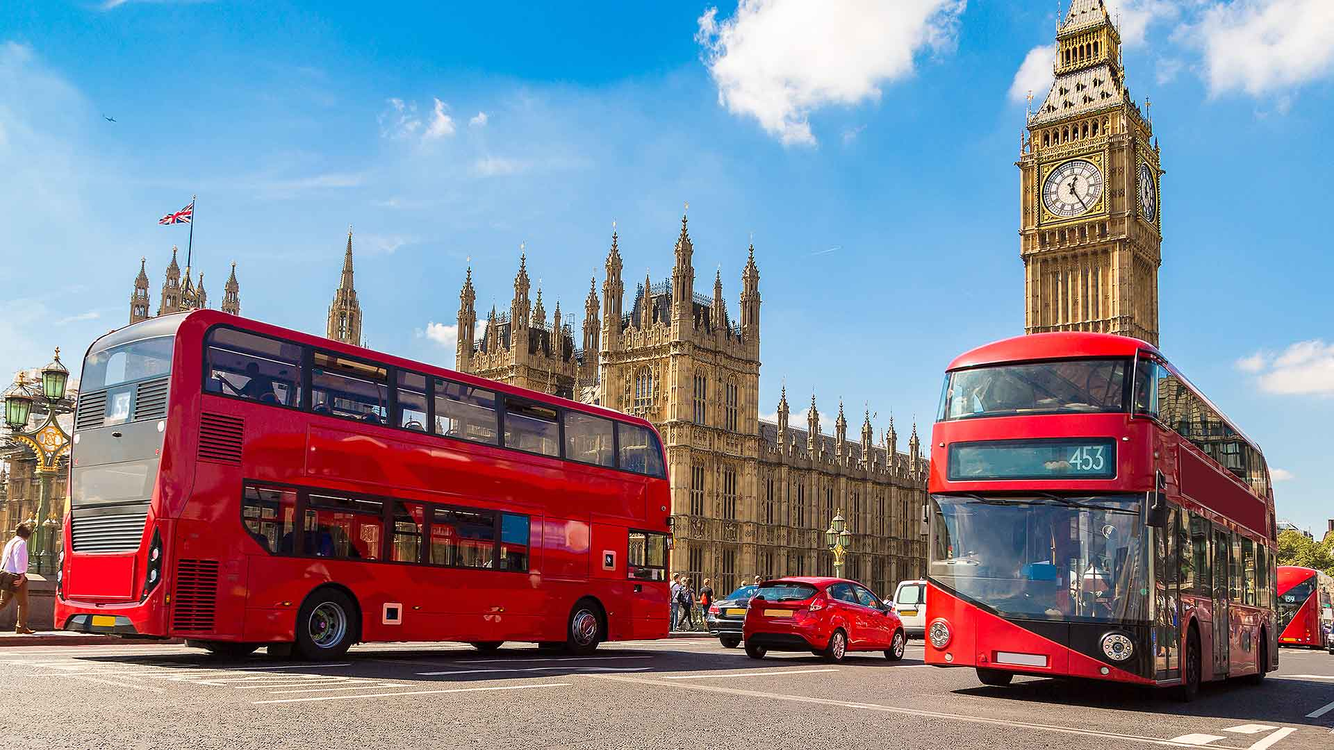 Cars and London buses on Westminster Bridge