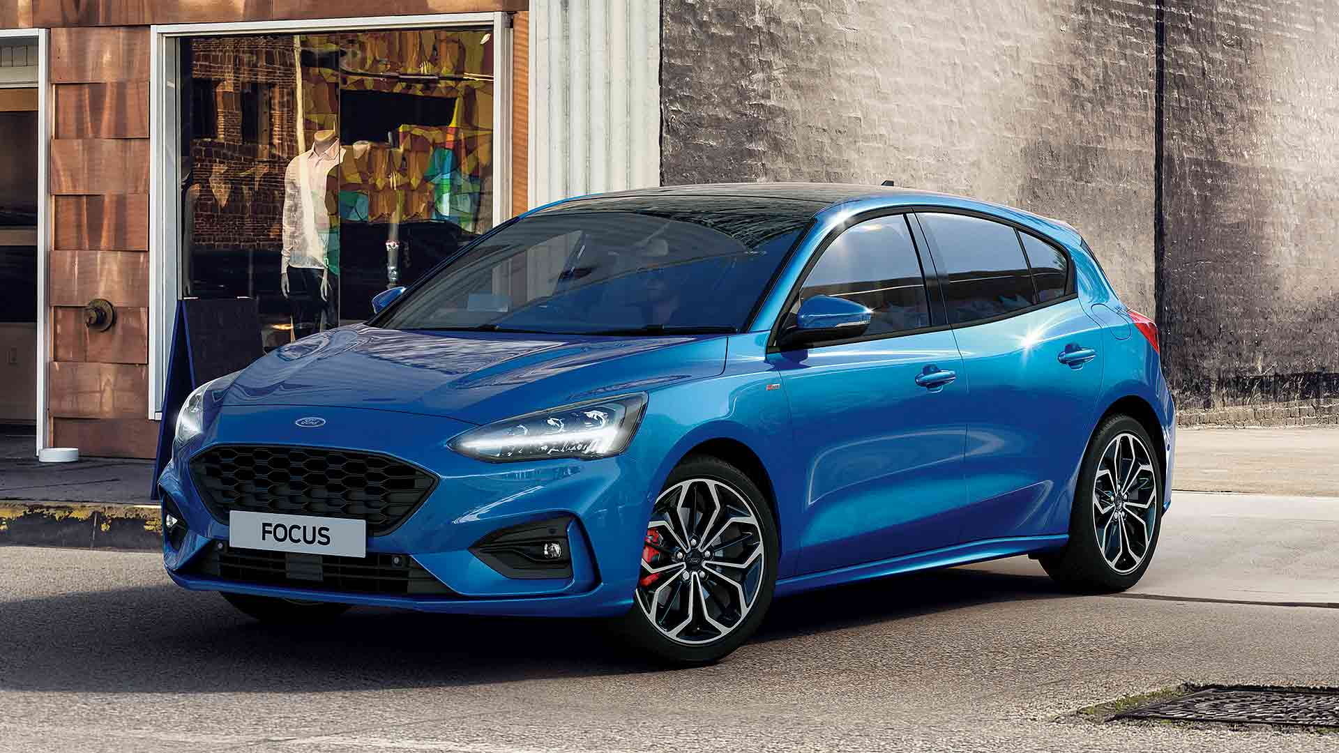 2020 Pull out the Ford Focus Ecoboost Hybrid in blue from a parking lot