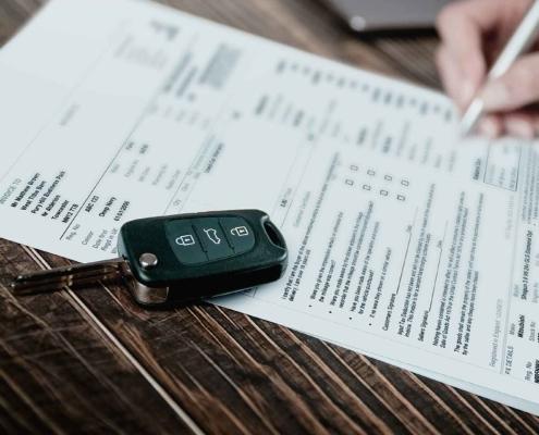 Customer signing a car finance loan agreement