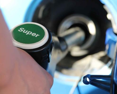Filling a car with super unleaded petrol