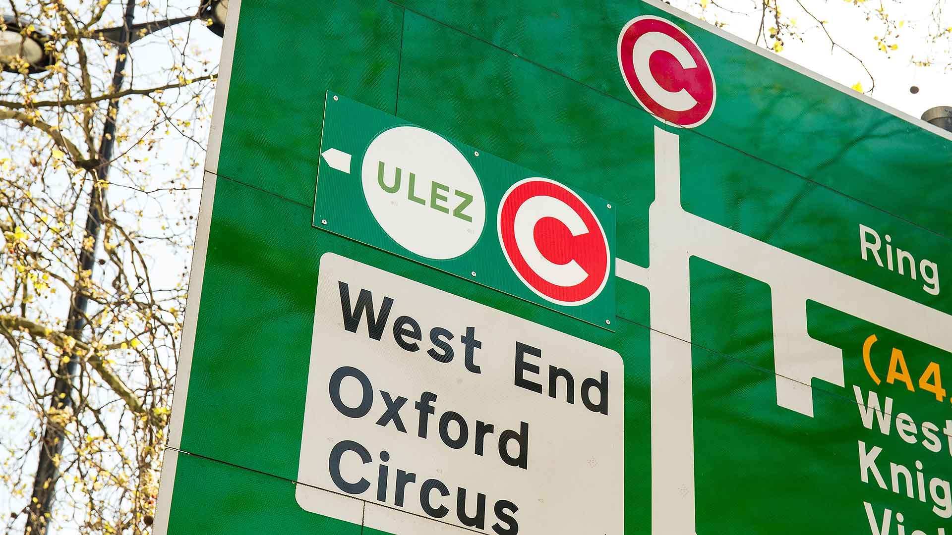 London ULEZ and Congestion Charge logo on road sign