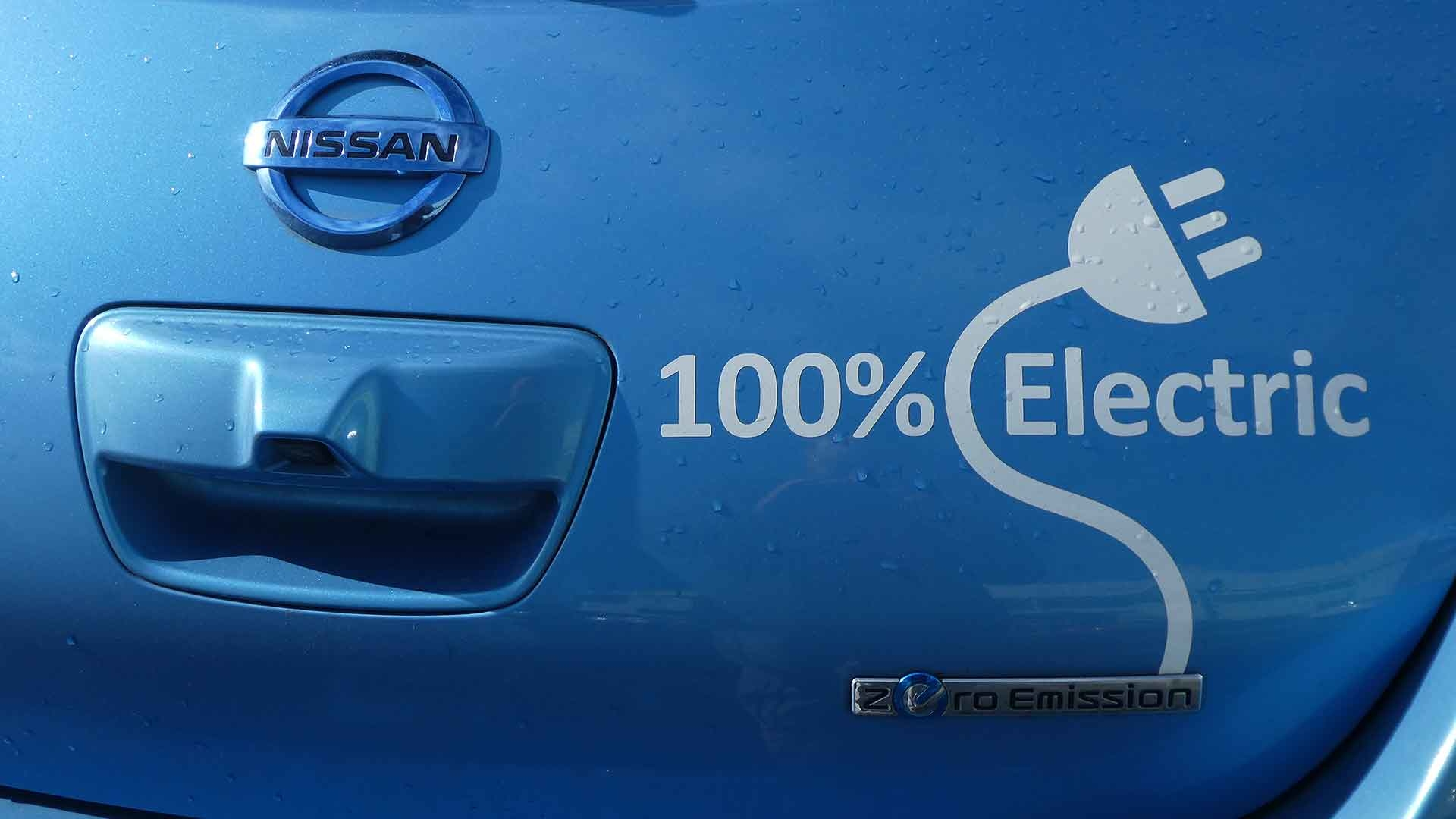 Nissan Leaf wearing a 100% electric logo